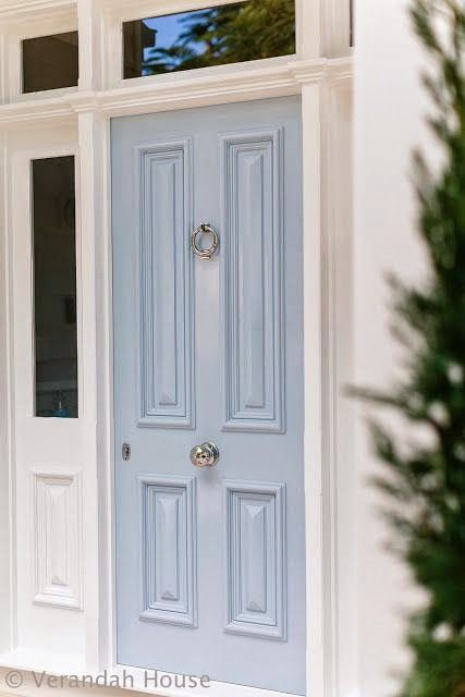 entrancing entrance...pale blue door, handsome hardware-it all works......the Clever Hanger would be a great addition to hang and center wreaths on the door knocker...nice find, Pippa!