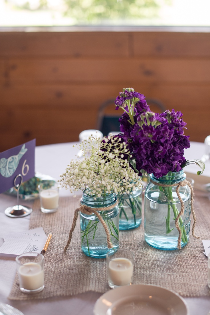 Teal Mason Jars, burlap, candles... This is more like what I was thinking, but sunflowers.