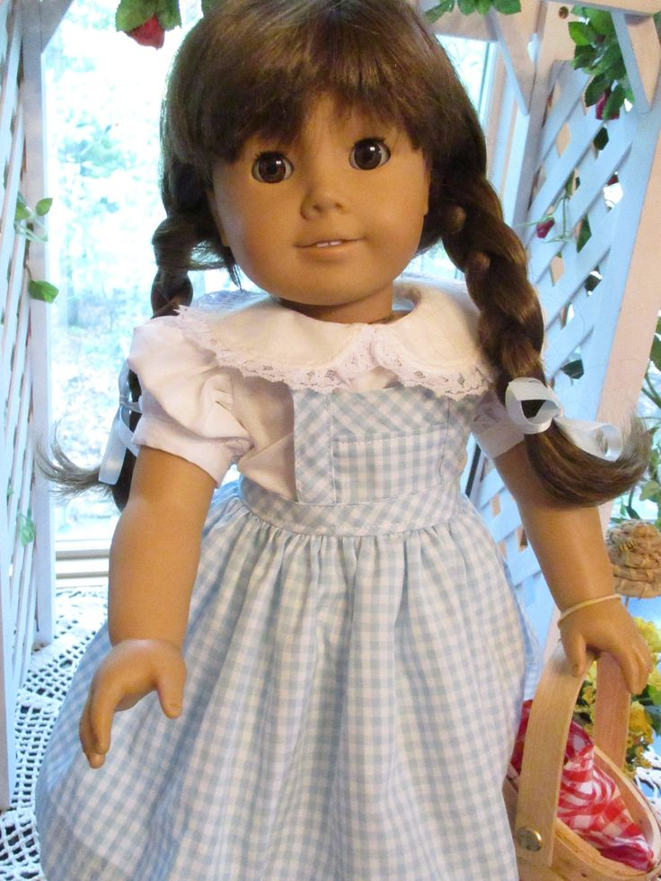 Created for play or display, this ensemble provides all the pieces to give your doll the complete Dorothy look. This 9-piece outfit includes: * Light Blue gingham jumper with bib apron styling and diagonally cut accents. It closes at the back waistline with thin velcro, has a machine blind hem finish, and serged seams for lasting value. * White cotton blouse with lace trimmed Peter Pan collar and the puffed sleeve cuffs. It closes in back with thin velcro and all seams are serged. * White…