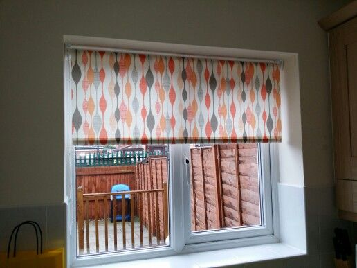 this ribbon orange roller blind added a nice touch of colour to this kitchen in st
