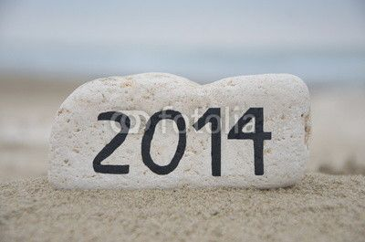 2014 on a white stone over the sand