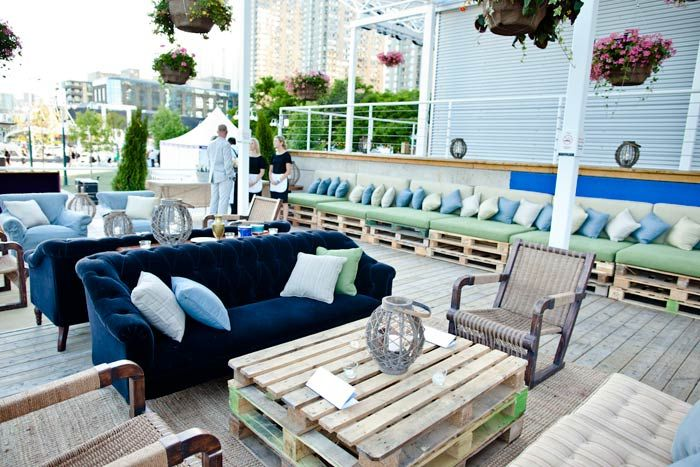 The V.I.P. area of Toronto's Power Ball was styled with rustic elements for an English-picnic look. Designers used loading palettes as banqu... Photo: Josh Fee for BizBash