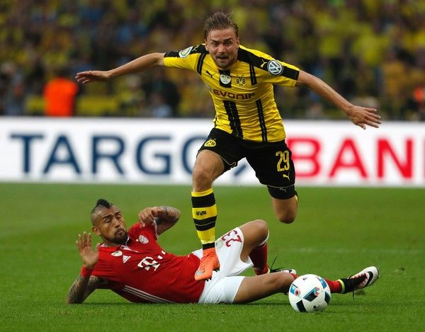 Bayern Munich's Chilean midfielder Arturo Vidal (L) and Dortmund's defender Marcel Schmelzer vie for the ball during the German Cup (DFB Pokal) final football match Bayern Munich vs Borussia Dortmund at the Olympic stadium in Berlin on May 21, 2016.