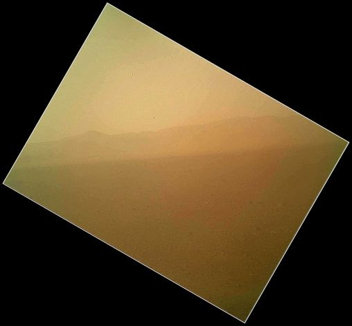This image released on Tuesday Aug. 7,2012 by NASA shows the first color view of the north wall and rim of Gale Crater where NASA's rover Curiosity landed Sunday night. The picture was taken by the rover's camera at the end of its stowed robotic arm and appears fuzzy because of dust on the camera's cover. Photo: NASA / AP