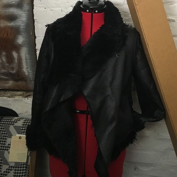 Black faux leather fur jacket BCBG DRAPE Used lightly. Mixed materials including wool size medium but also stretches. Can fit s-L really. Interior is faux fur. Black. BCBGMaxAzria Jackets & Coats