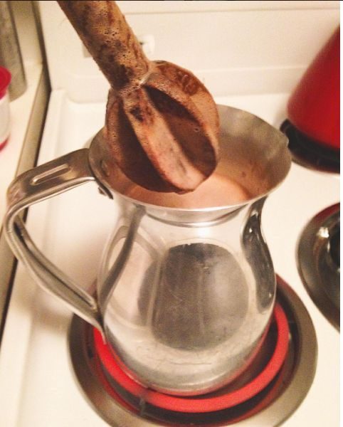 Everybody's abuela has their own way of making Colombian hot chocolate but it typically goes like this: You heat milk and chocolate in a chocolatera and you whisk the fuck out of it with a molinillo to create some frothy goodness. | We Need To Talk About Dunking Cheese Into Your Hot Chocolate