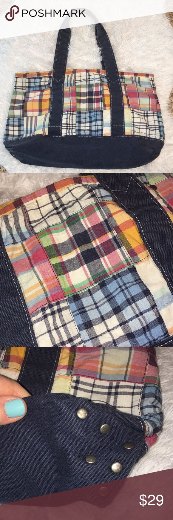 J. CREW Classic Madras Plaid tote Bag Purse This is a J. CREW Classic Madras Plaid tote Bag Purse in used condition! Outside is clean ! Navy trim feels like canvas! Interior is khaki tan color and does have a stain in corner, I added a closeup pic too! I ship fast! Happy poshing friends! J. Crew Bags Totes
