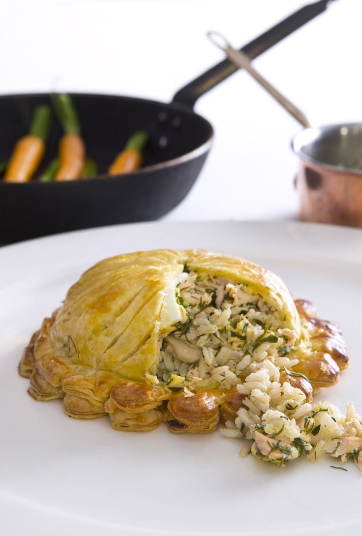 Making the most of Tilda's nutty brown basmati rice, this salmon fish pie recipe is based on a classic Russian coulibiac. To make individual pies, chef Andrew Mackenzie flakes the salmon with a mixture of rice, mushrooms and herbs for a delicious filling for the puff pastry cases.
