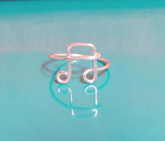 This is my signature wire music note ring. It has an elegant, simple and smooth design. This delicate ring is a perfect gift for someone who