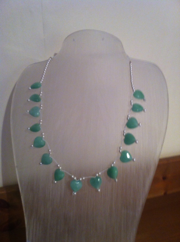 Jade hearts and tiny pearls.