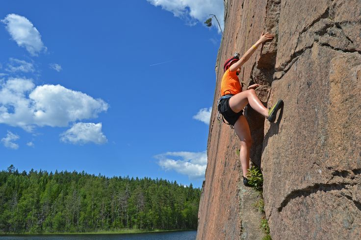 Wild nature experiences in Finland: climbing up or down the Olhava cliff The rock face of Olhava is 45m long and ends in lake. As you can walk to top of the cliff, it offers a chance for descents as well as rope climb ups.