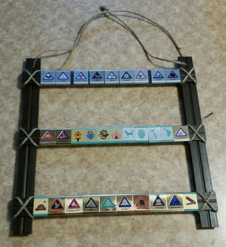 Cub Scout belt loop display with 5 wood rulers. Glue and add twine. Easy and cheap!