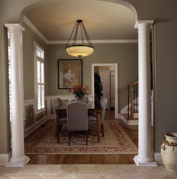 Gorgeous dining room with stately columns dining room for Dining room entrance