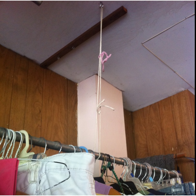 Saw this at a garage sale this weekend easy way to hang for Cheapest way to build a garage