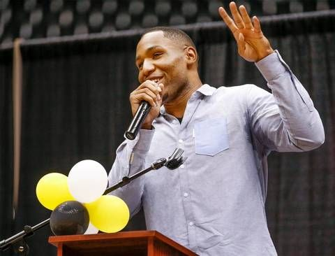 Wichita State's Tekele Cotton addresses the crowd at the WSU basketball awards celebration at Koch Arena Thursday. (April 16, 2015)