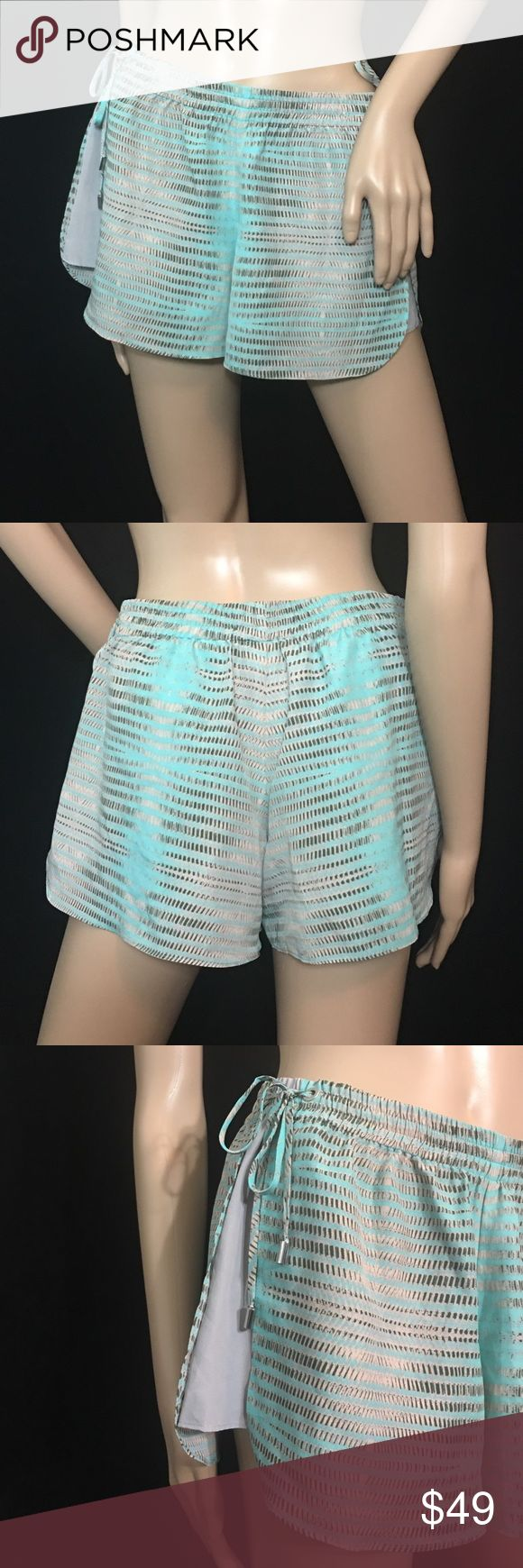 Armani Exchange Shorts Great shorts to use as a cover-up at the pool or to dress up for a night out on the town • Has really cute drawstring ties at both sides of the hips • Lightweight polyester material • Like new • Release date: Summer 2013 •Size is 0, but would fit a 3/4 to 7/8 pant size • Colors are turquoise & grey Armani Exchange Shorts