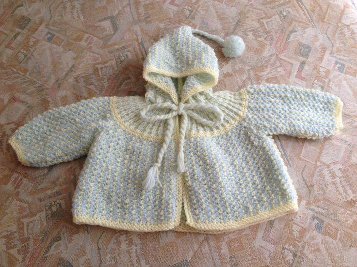 Light blue &yellow hand knitted baby jacket - Lichtblauw & geel handgebreid babyjasje