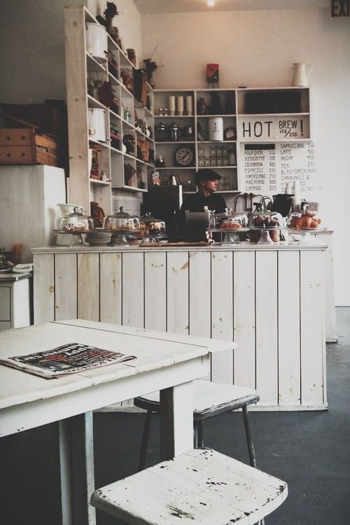 lovely coffee shop interior white painted wood consider a great storage unit behind the cash to showcase boxed