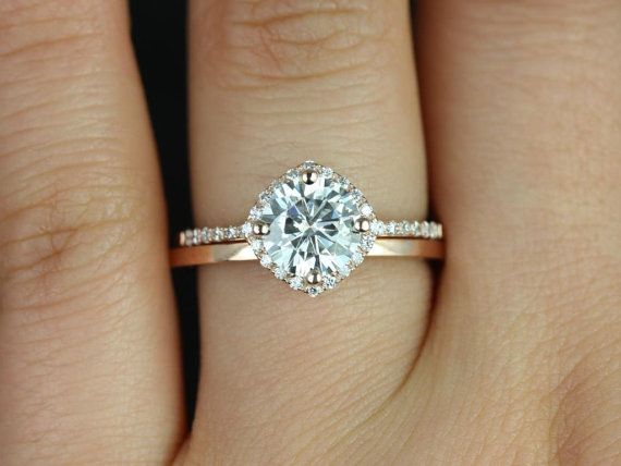 This engagement ring is designed for those who love simple with a slight twist. The round cut in the center is traditional while the cushion halo set