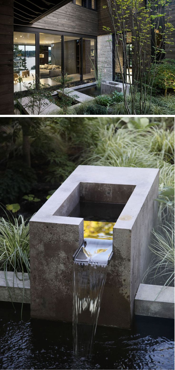 In this small and modern courtyard, there's a concrete water feature and plants that can be viewed from both levels of the home. #Courtyard #Landscaping #WaterFeature