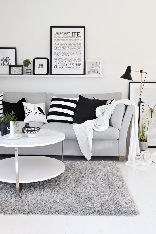 Black & white, words on wall, green plants and lots of pillows