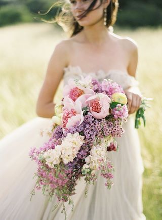 Lilacs, peonies, and tulips flourish in this cascading bouquet from Florabundance with styling by Kelly Oshiro; Photo by Jose Villa and call (310) 882-5039 if you need a Los Angeles officiant https://OfficiantGuy.com