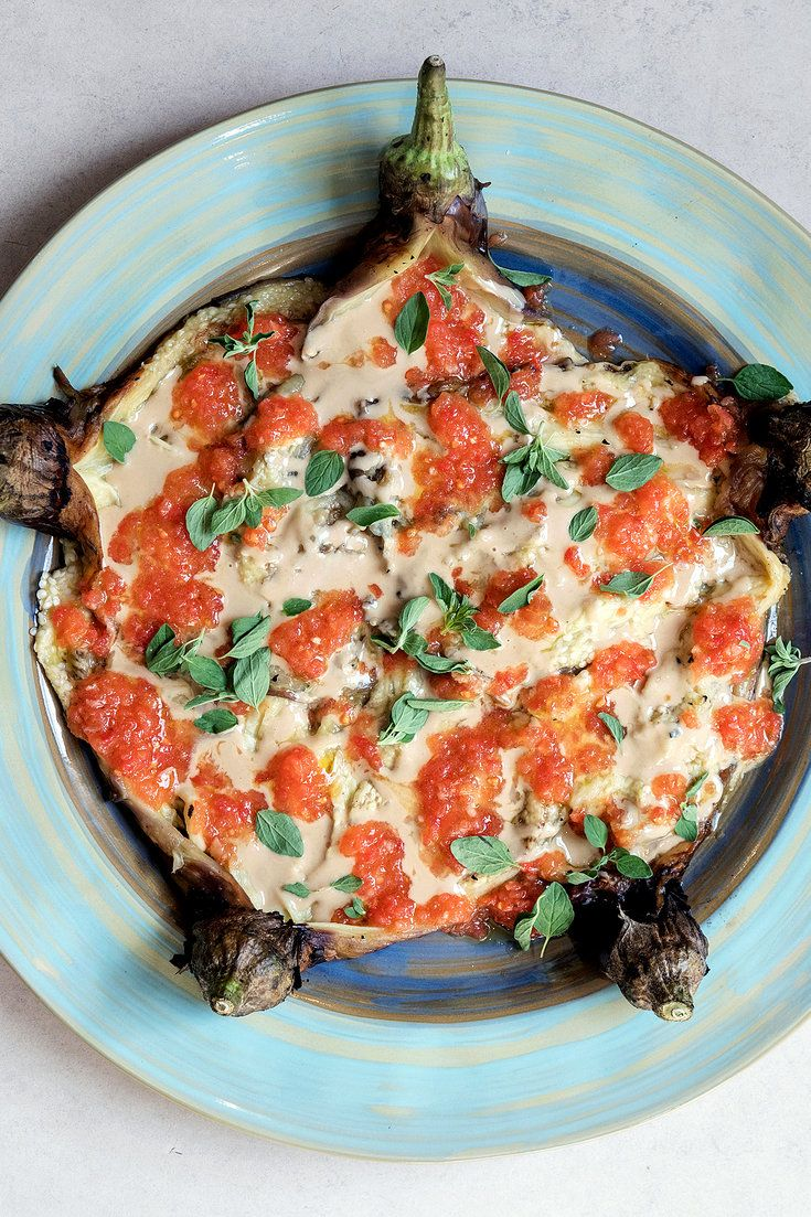 For this summery recipe, eggplant is charred on the stove – or, if the weather cooperates, on a grill – and fanned out onto a plate. Drape over it some olive oil and tahini, a deeply flavored tomato mixture and a sprinkle of good salt. (Photo: Carol Sachs for The New York Times)