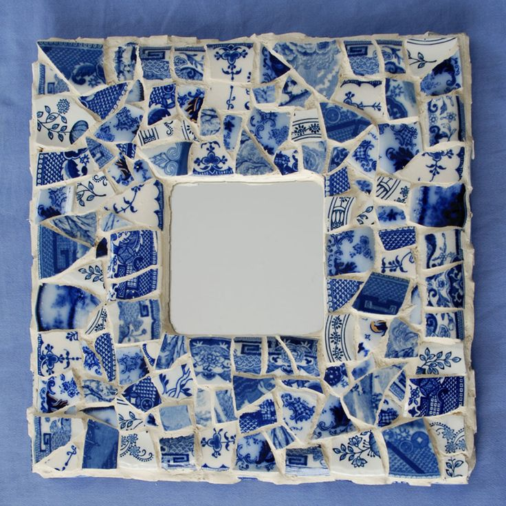 "flow blue mosaic mirror The china pieces in this mosaic frame include:   ""Astoria"" Flow Blue pattern (one of my favorites)  ""Kelvin"" Flow blue pattern  3+ different Blue Willow sources.  A Japanese version of blue onion china."