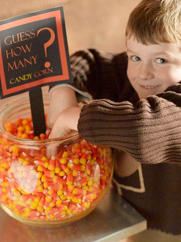 Guess how many candy corn for a fun and easy party game! More ideas here: http://www.bhg.com/halloween/parties/halloween-party-games/?socsrc=bhgpin083014candycorn&page=7