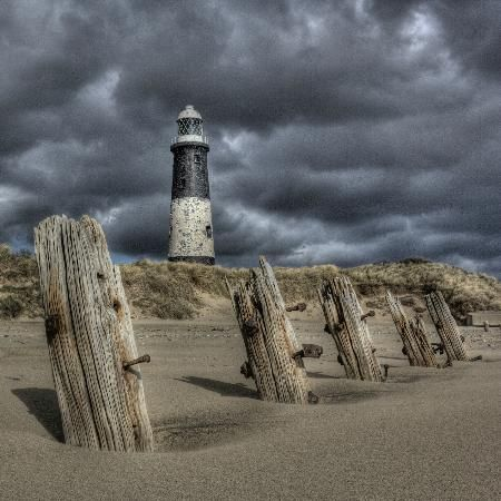 East Riding of Yorkshire, UK: Spurn Lighthouse beneath ominous skies www.waysideflower.co.uk