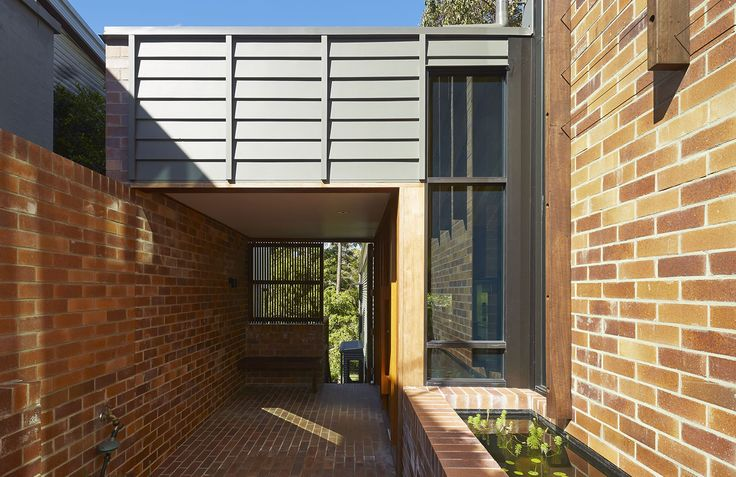 St Lucia House 2: Covered porch transitions between inside and outside. See more at http://blighgraham.com.au/projects/st-lucia-house-2-2013