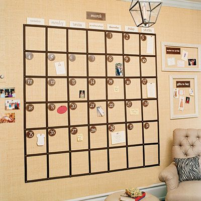 Wall Calendar from Southern Living.  Layer of corkboard underneath to create wall-size bulletin board.  Can create framed areas to section off or display photos or children's artwork.  Link takes you through a step-by-step tutorial of how to create.  Recommended to use textured paper like raffia or grasscloth over cork to hide holes left by pushpins.