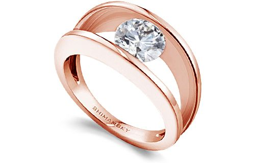 The unique and extremely beautiful rose gold Millennium diamond engagement ring illuminates a romantic and natural feel. View the engagement ring here.