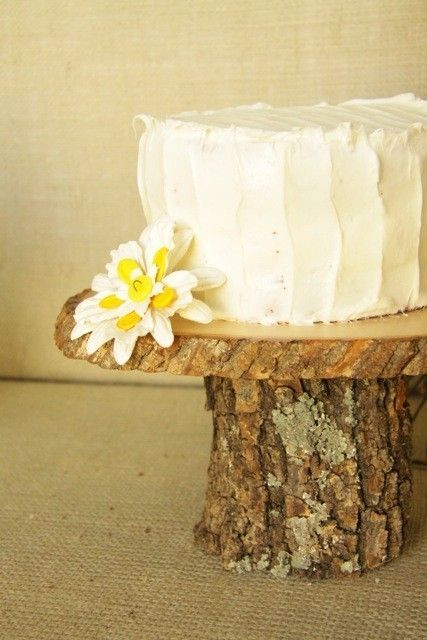 simple and clean cake on wood stand