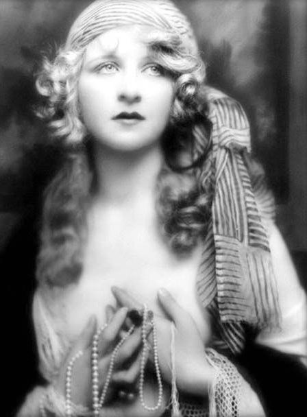 "1920's Gypsy Style -Myrna Darby ""Born in Pittsburgh, Myrna Darby, appeared in six Ziegfeld productions—""No Foolin',"" ""Rio Rita,"" ""Follies of 1927,"" ""Rosalie,"" ""Three Musketeers,"" and ""Whoopee""—before her death from an inflammation of the heart at age 21. She fell ill during the run of ""Whoopee"" and though reputedly one of the highest paid showgirls in New York, left an estate of only $750. Strikingly photogenic, she was one of the most photographed of the Ziegfeld girls in the 1920s…"