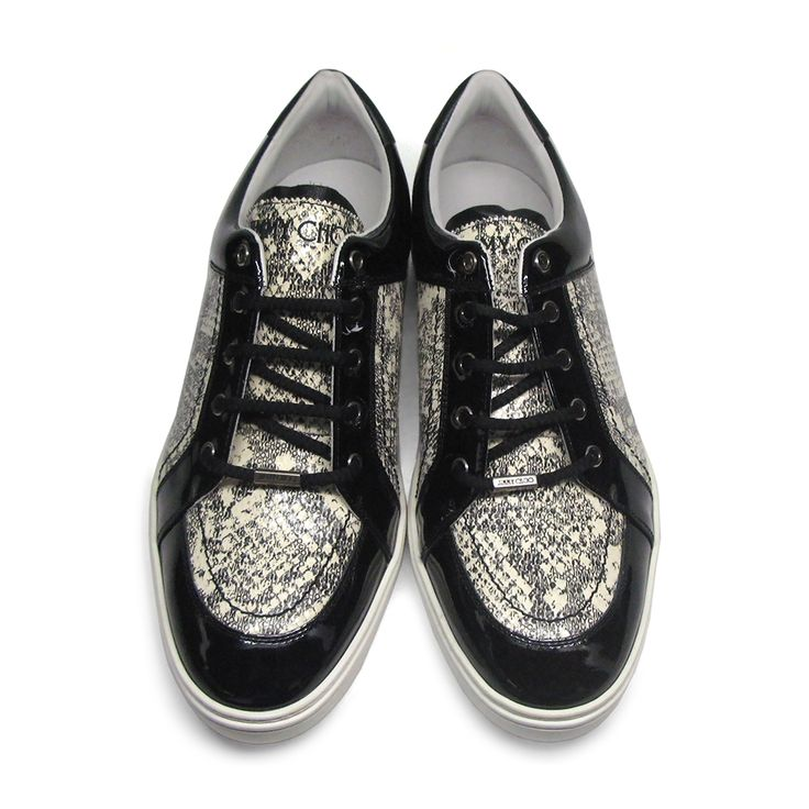 Fantastic Sydney snake print sneakers from Jimmy Choo. Crafted from luxurious leather these lust worthy low tops combine urban attitude with exquisite detailing.Size: 45.Made in Italy.