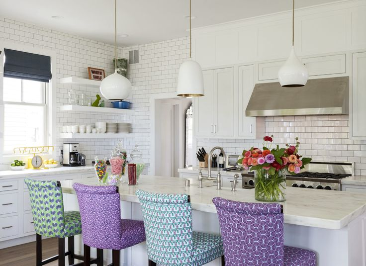 Love the fabric colours and patterns on the breakfast bar chairs.