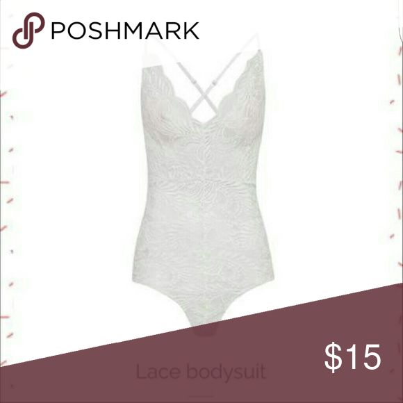 Ladies bodysuit. NWT Never worn. Is see through. Tops Camisoles