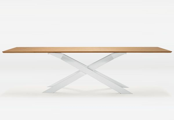 Cross table, designed by Gianluigi Landoni natural oak top and white base bit.ly/1uha88r