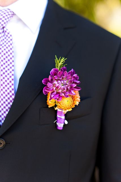 swap the purple flower out for orange for the groomsmen, white for Zack - change ribbon color - if monochromatic then it won't look so busy