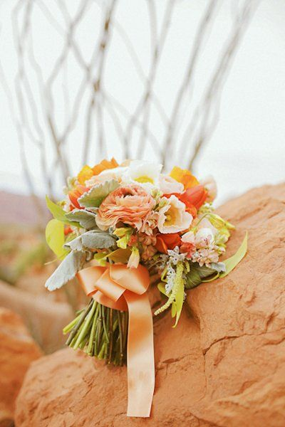 Orange wedding bouquet    {photo credit: GIDEON PHOTOGRAPHY}