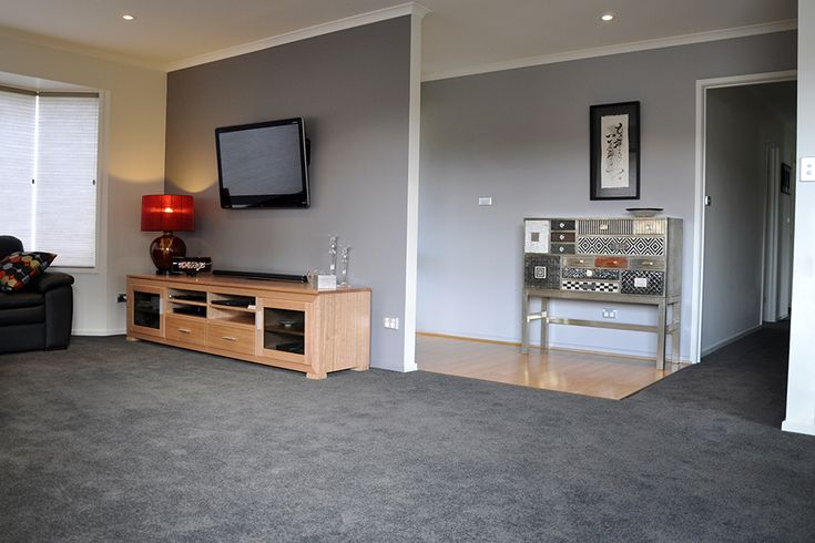 complimenting the smokey grey carpet for a harmonious living room