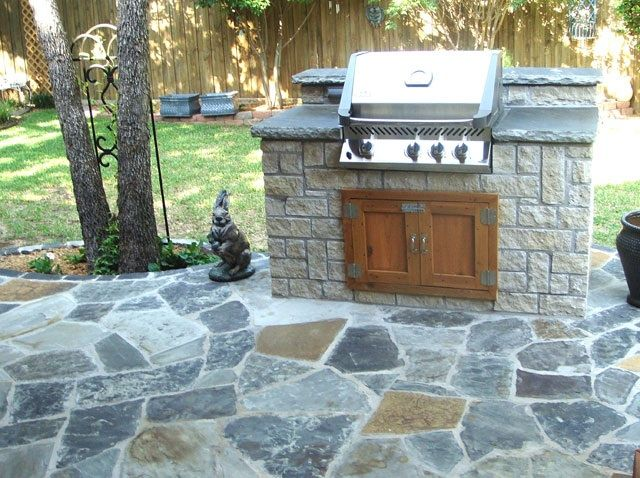 GroundScape And Fort Worth Landscape Company, Stones In An Outdoor Grill  With Custom Cedar Doors