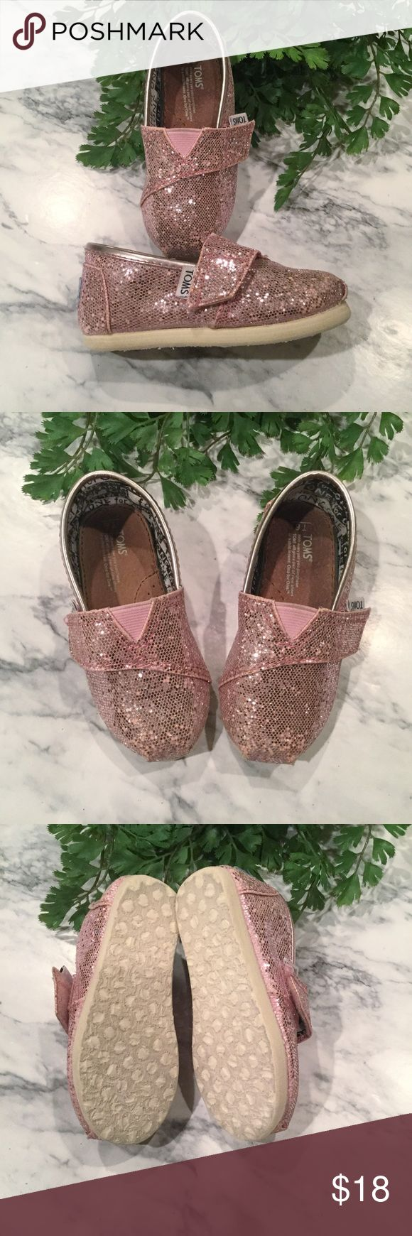 TINY TOMS Pink Glitter Toddler Shoes Slip On T6 6 🍃🍃🍃🍃🍃🍃🍃🍃🍃🍃🍃🍃  Tiny Toms pink glittery toddler size T6 or 6. Perfect for your little princess. 🌸🌸🌸 Freshly washed and ready to go. Velcro closure. Photos show condition. I have another pair of Toms in another listing if you would like to bundle them together, save 20% and pay only one shipping fee.    💕🍃💕 Offers welcome 💕🍃💕 Toms Shoes