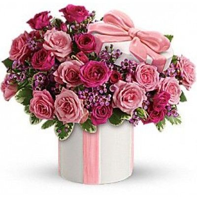 Hats off to an adorable gift for Mom. She'll be totally charmed by the sweet bouquet of pink roses and the delightful ceramic hat box with its sculpted pink ribbon.