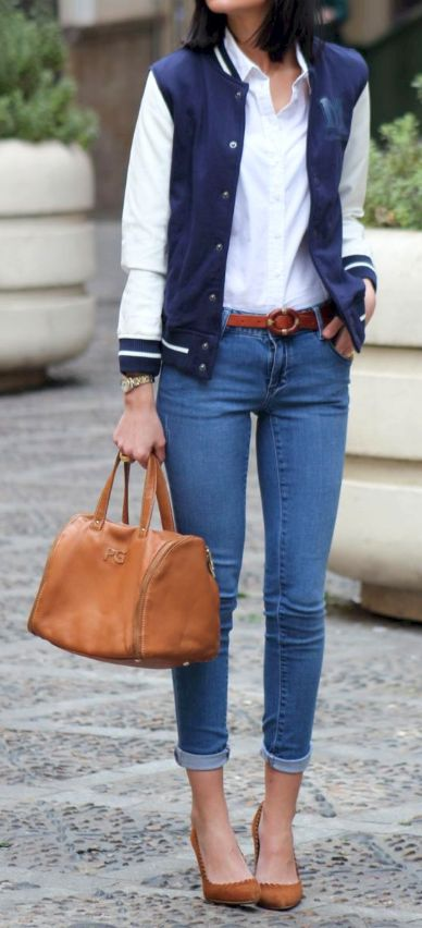 I love this super cute varsity jacket as she used it as an accent jacket over that cute white top. The heels make the perfect fit with the over appeal of the outfit!