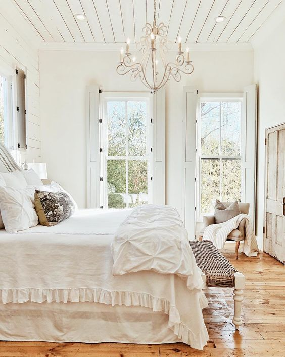 French Farmhouse Bedroom with shiplap ceiling, shutters, chandelier, and rustic wood floors #FrenchFarmhouse