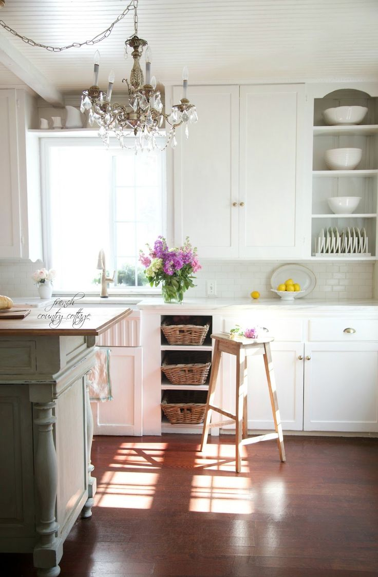 Shop Shop Whitehaus Collection Farmhaus 20-in x 30-in White Single-Basin Fireclay Apron Front/Farmhouse Kitchen Sink at Lowes.com, Shop Delta Cassidy Touch2O Champagne Bronze 1-Handle Pull-Down Touch Kitchen Faucet at Lowes.com, Shop Home Styles 48-in L x 25-in W x 36-in H Black Kitchen Island at Lowes.com, Shop American Olean Starting Line White Gloss Brick Mosaic Ceramic Wall Tile (Common: 12-in x 12-in; Actual: 12-in x 12-in) at Lowes.com, Shop Amerock Revitalize Gilded Brass Round…