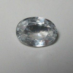 Batu Permata Sapphire berwarna putih bening, luster tajam berkerlip atraktif berukuran 5.85mm x 4.15mm x tebal 2.32mm, berat 0.51 carat bentuk oval cut. Ukuran pas untuk cincin nikah.
