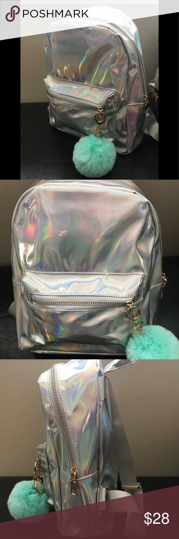 Holographic silver backpack 🎒 Cute Holographic Backpack silver zipper closure   Adjustable straps and pocket inside with zipper NWNT , Pom included Gigi's Bags Accessories Bags